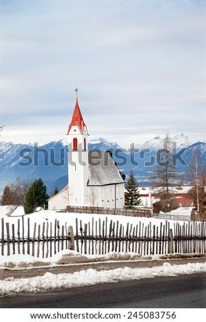 The rural church in small alpine village, Austrian - stock photo