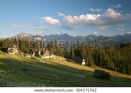 The rural landscape on a background of Carpathian at dusk. - stock photo