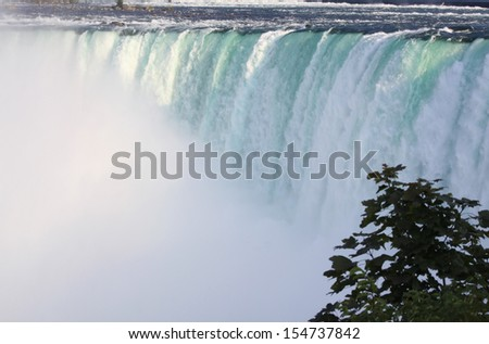 The rushing water of Horseshoe Falls at Niagara Falls from a distance. August 22nd, 2013 - stock photo