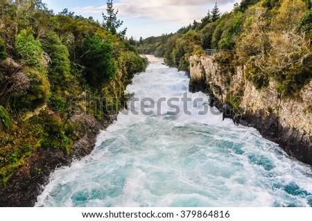 The rushing wild stream of Huka Falls near Lake Taupo, New Zealand - stock photo