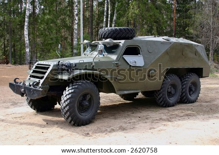 The russian 3 axes armored car at the sand. - stock photo