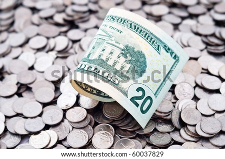 The Russian coins and the American dollars - stock photo