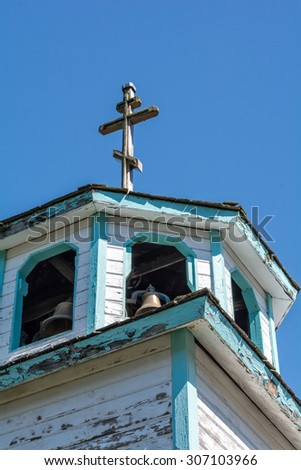 The Russian cross on top of an old church steeple has weather the years well. - stock photo