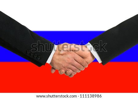 The Russian flag and business handshake - stock photo