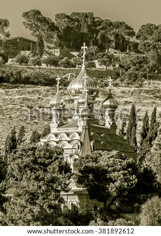 The Russian Orthodox church of Mary Magdalene at the mount Olives - Jerusalem, Israel (stylized retro) - stock photo