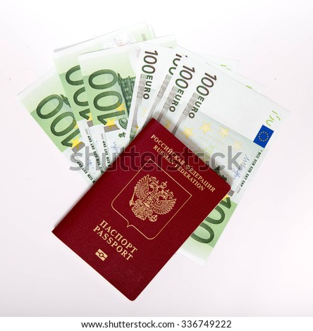 The Russian passport in a red cover lies on a pile of notes (euro) - stock photo