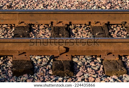 The rusted train tracks. - stock photo
