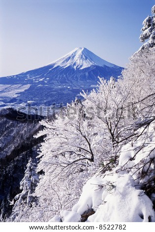 The Sacred Fuji in winter as a view from mountain peak - stock photo