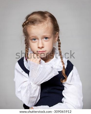 the sad schoolgirl braids - stock photo