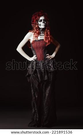 The sad young woman with muertos makeup (sugar skull). Full length  - stock photo
