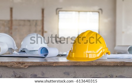 Safety helmet blueprint on table construction stock photo the safety helmet and the blueprint on table at construction site malvernweather Gallery