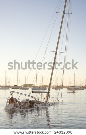 The sailboat sank after a serious storm. - stock photo