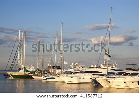 the sailboats standing in port against the blue sky - stock photo