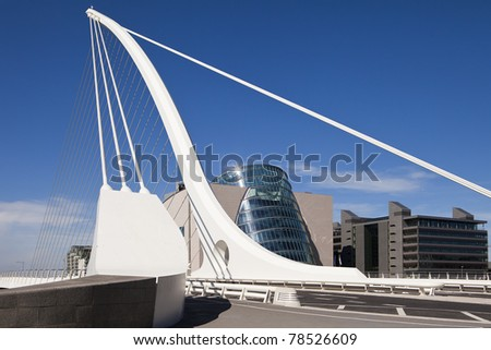 The Samuel Beckett Bridge is the newest bridge to cross the River Liffey in Dublin, Ireland. The modern structure is curved in the shape of a harp and uses cables, like a suspension bridge. - stock photo