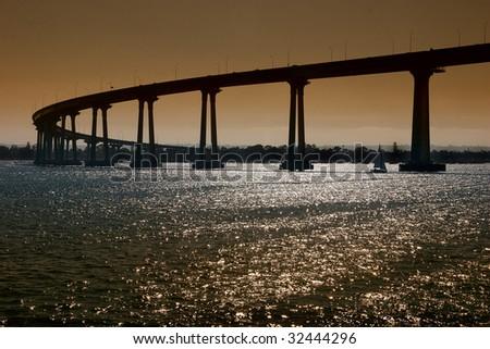The San Diego-Coronado Bridge, locally referred to as the Coronado Bridge crossing over San Diego Bay linking San Diego with Coronado, California. - stock photo