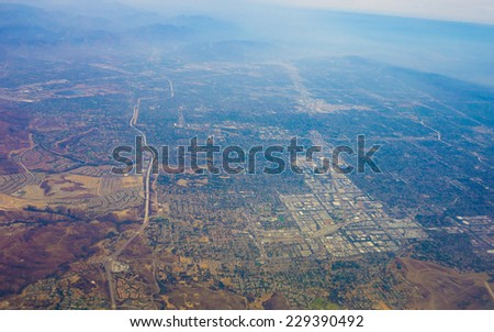 The San Fernando Valley aka The Valley in the Los Angeles metropolitan area of southern California defined by the mountains of the Transverse Ranges circling it - stock photo