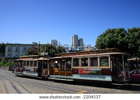 The San Francisco cable car system is the world's last permanently operational manually-operated cable car system, and is now an icon of the city of San Francisco in California. - stock photo