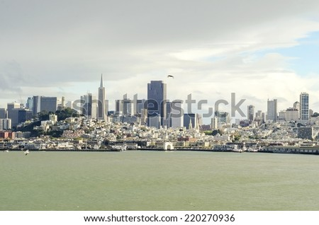 The San Francisco skyline in California,United states of America from Alcatraz island. A view of the cityscape,skyscrapers,architecture,fisherman's wharf, piers, Transamerica pyramid and coit tower. - stock photo