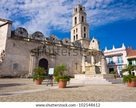 The San Francisco Square and the church with the same name in Old Havana , a touristic landmark famous for its traditional architecture and its cultural importance in Old Havana - stock photo