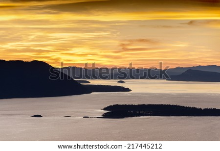 The San Juan Islands. Sunset over the San Juan Islands of Puget Sound in western Washington State, USA. Orcas Island, Clark and Barnes Island with Matia and Sucia in Canadian waters in the background. - stock photo