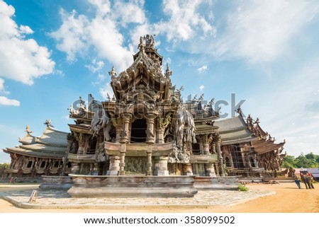 the sanctuary of truth against a blue sky in pattaya,  thailand. - stock photo