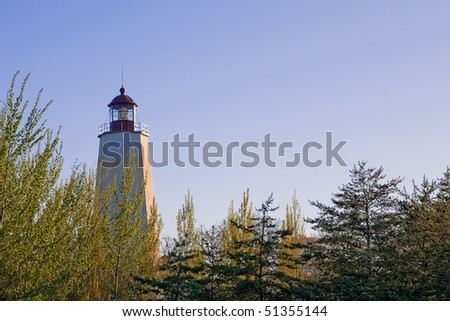The Sandy Hook Lighthouse, at late afternoon. - stock photo