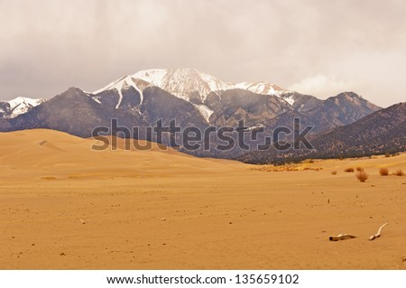 The  Sangre de Cristo Range in snow above the Great Sand Dunes in Colorado - stock photo