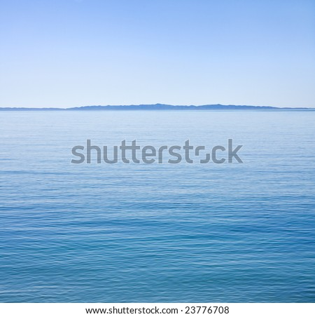 The Santa Barbara channel on an unusually calm day with Santa Cruz Island in the background. - stock photo