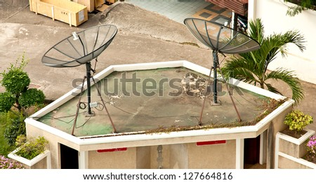 The satellite dish is installed on top of the building. - stock photo