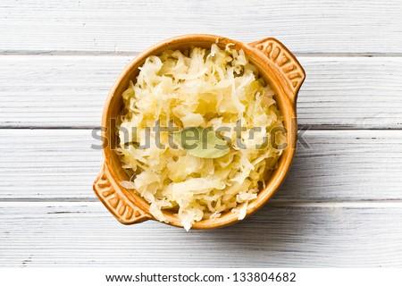the sauerkraut in ceramic bowl - stock photo