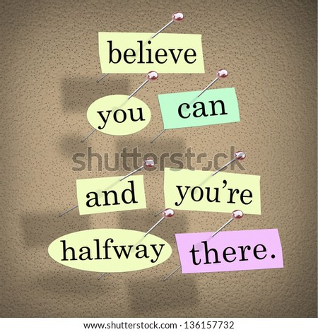 The saying Belive You Can and You're Halfway There on pieces of paper pinned to a bulletin board to symbolize belief, confidence, dedication and determination - stock photo
