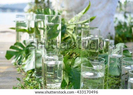 The scenery for wedding composed of plants and glasses. - stock photo