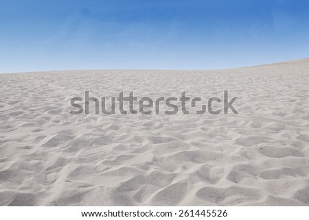 The scenery of sand desert with clear blue sky  - stock photo