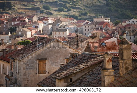 The scenic rooftops and houses of the town Komiza on the island of Vis in Croatia