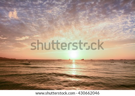 The scenic sunset from the beach of Boracay island, Philippines