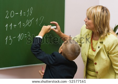 The schoolboy solves examples at a mathematics lesson - stock photo