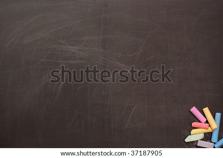 The scratched used up school board with a colour chalk - stock photo