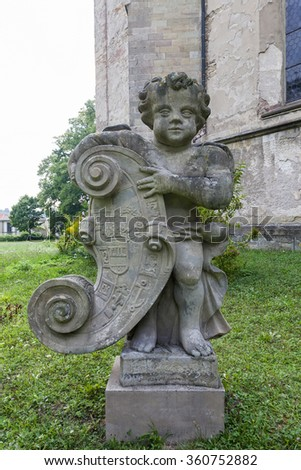 The sculpture of a boy - angel - stock photo