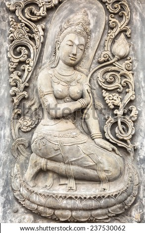 The sculpture of native Thai style decorative on the wall in public temple  - stock photo