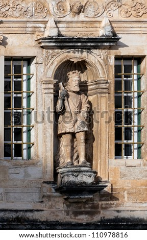 The sculpture of the old king in Patio das Escolas of the Coimbra University in Portugal - stock photo