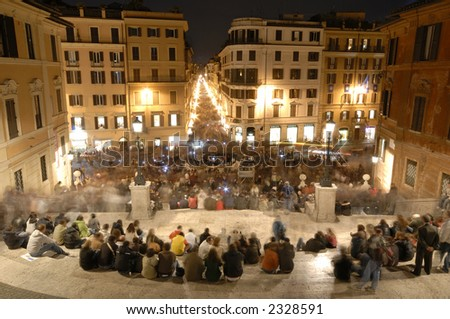 The sea of people in Piazza di Spagna and Via Condotti, Rome, during a Pope visit on december 2006 - stock photo