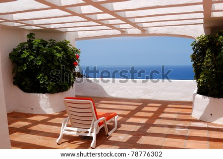 The sea view from a terrace of luxury hotel, beach and Atlantic Ocean, Tenerife island, Spain - stock photo