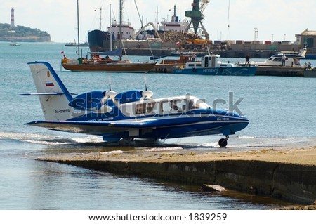The seaplane Be103 leaves water - stock photo