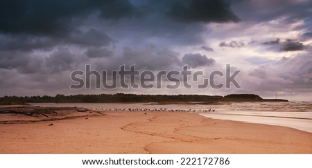 The seashore on a stormy day - stock photo