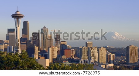 The Seattle skyline on a clear autumn evening with Mount Rainier in the background - stock photo