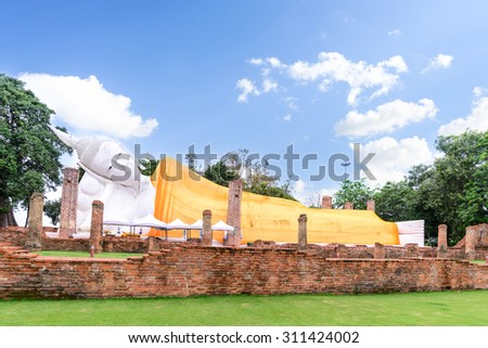 The second longest reclining buddha, 50 metres in length at Wat Khun Inthapramun public temple in Thailand. - stock photo