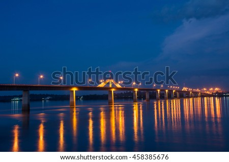 The second thai - lao friendship bridge across the mekong river at mukdahan, thailand. Background soft and blurry focus.