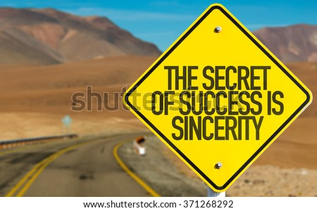 The Secret of Success is Sincerity sign on desert road - stock photo
