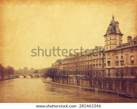 The Seine near the Pont Neuf, Paris, France. Photo in retro style. Added paper texture. Toned image - stock photo
