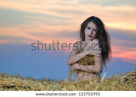 The seminude girl on a haystack - stock photo